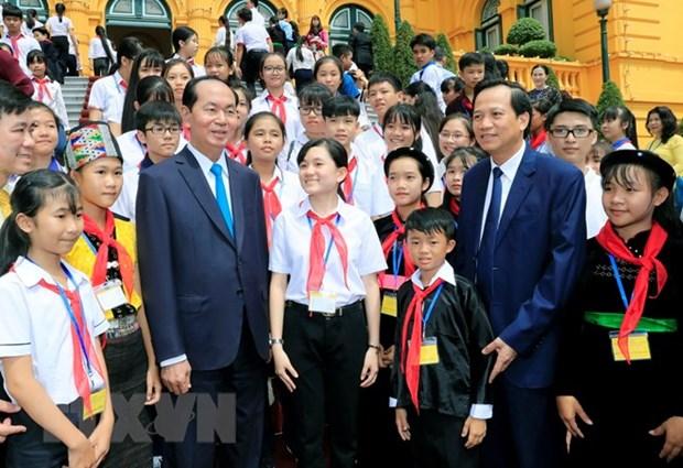 Le president Tran Dai Quang recoit des enfants en difficulte du pays hinh anh 2