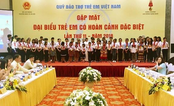 Le president Tran Dai Quang recoit des enfants en difficulte du pays hinh anh 3