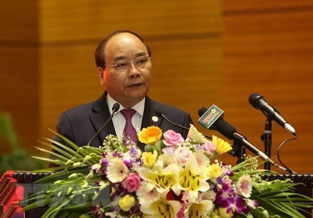 Le PM Nguyen Xuan Phuc a la conference politico-militaire de l'Armee hinh anh 1