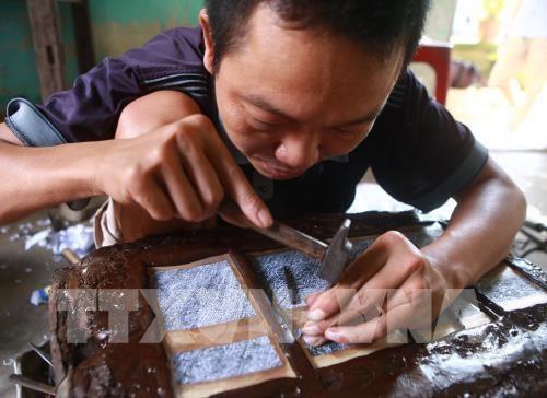 Dong Xam honore une tradition d'orfevrerie haute en couleurs hinh anh 1