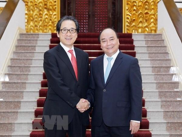Le Premier ministre Nguyen Xuan Phuc recoit le president de la JETRO hinh anh 1
