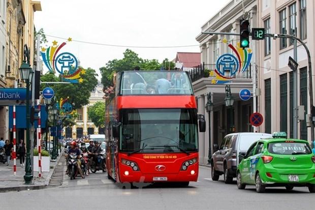 Decouvrir la nuit de Hanoi en bus a imperiale a toit ouvert hinh anh 1
