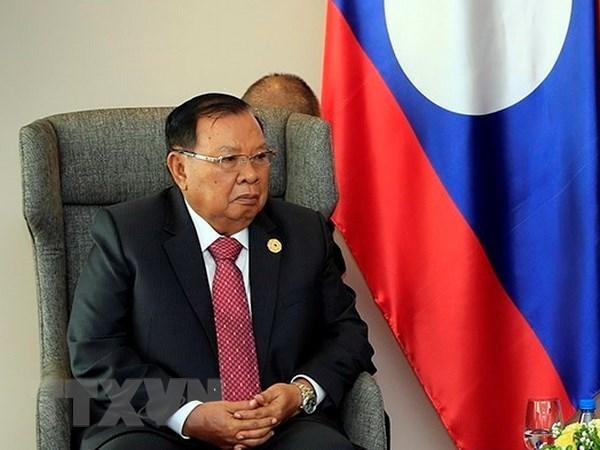 Le secretaire general du PRPL recoit la delegation du Parti communiste du Vietnam hinh anh 1