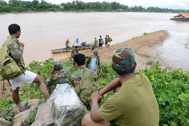 Barrage effondre au Laos : les secouristes a la recherche des portes disparus hinh anh 1