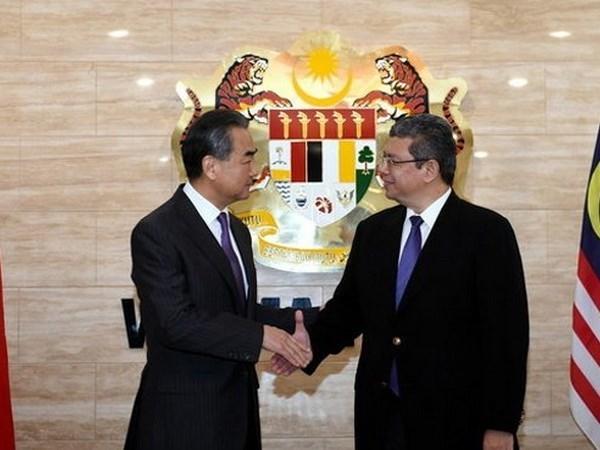 Les ministres des AE de Chine, des Etats-Unis et d'Australie en visite en Malaisie hinh anh 1