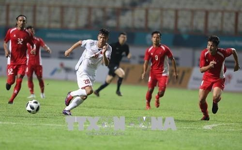 Football : le Vietnam bat le Nepal 2-0 aux ASIAD 18 hinh anh 1
