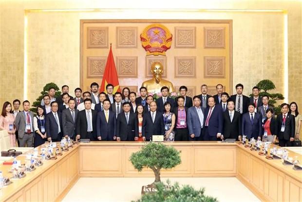Le PM engage les Viet kieu a participer au developpement scientifique et technologique au Vietnam hinh anh 3