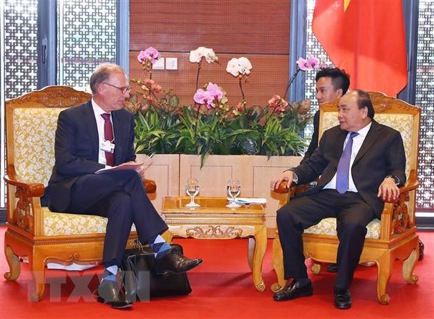 WEF ASEAN 2018 : le PM recoit le directeur general de Carlsberg hinh anh 1