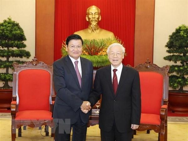 Le leader du PCV recoit le Premier ministre laotien hinh anh 1