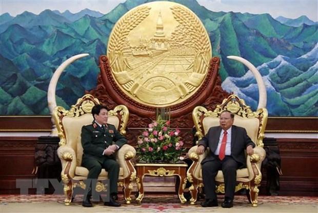Le general de corps d'armee Luong Cuong en visite officielle au Laos hinh anh 1