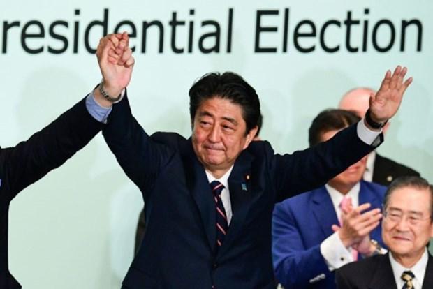 Le leader du PCV felicite le PM japonais pour sa reelection a tete du PLD hinh anh 1