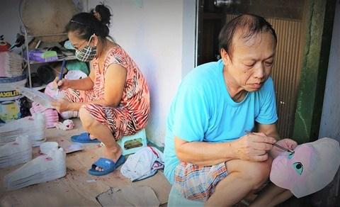 Les derniers Mohicans des masques en papier mache a Hanoi hinh anh 1