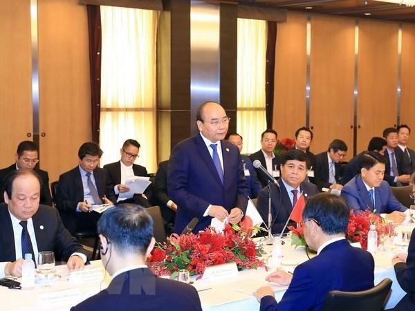 Le PM Nguyen Xuan Phuc rencontre des responsables de grandes societes financieres japonaises hinh anh 1