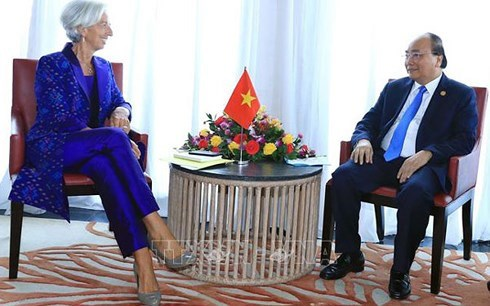Le PM Nguyen Xuan Phuc aux assemblees annuelles du FMI et de la BM hinh anh 1