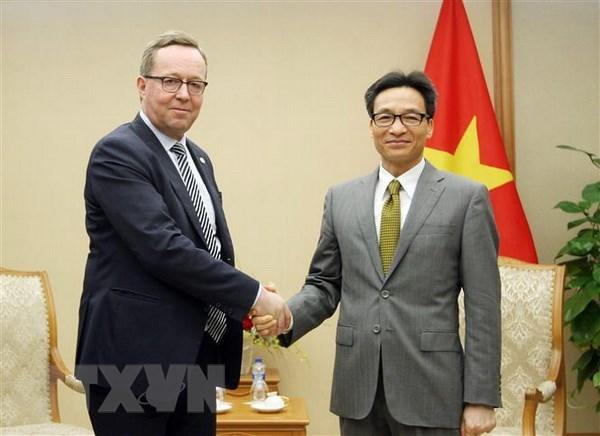 Le vice-PM Vu Duc Dam recoit le ministre finlandais de l'Economie hinh anh 1