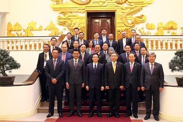 Le vice-PM Vu Duc Dam recoit les chefs des delegations de l'AMMD-6 hinh anh 1