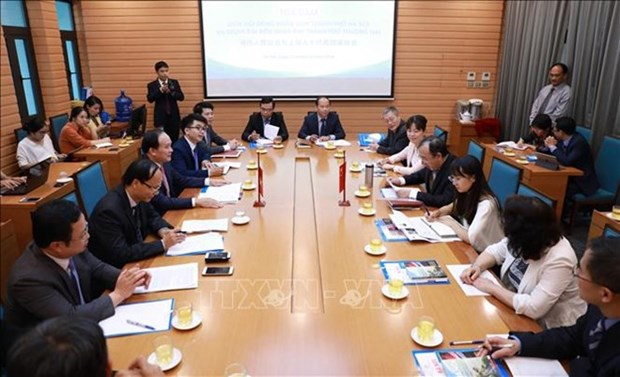 Hanoi et Shanghai partagent leurs experiences dans les activites du conseil populaire hinh anh 1