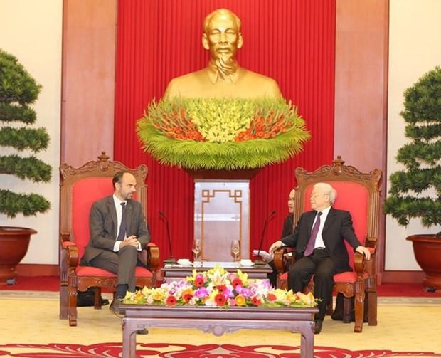 Le leader du PCV et president Nguyen Phu Trong recoit le PM francais Edouard Philippe hinh anh 1