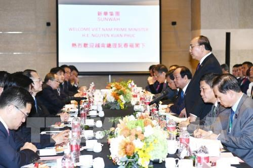 Le PM participe a un echange de vue avec les groupes chinois hinh anh 1