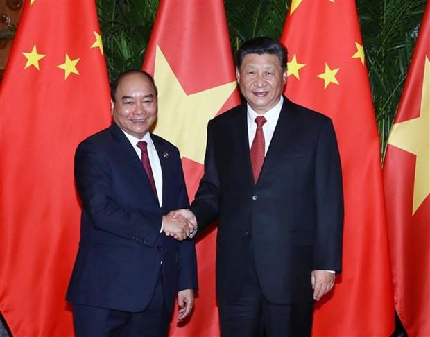 Le PM Nguyen Xuan Phuc rencontre le dirigeant chinois Xi Jinping a Shanghai hinh anh 1