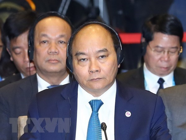 Le PM Nguyen Xuan Phuc participe au 20e sommet ASEAN-R. de Coree hinh anh 1