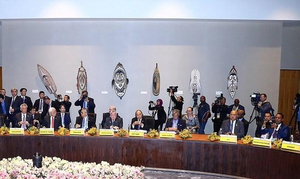 Le PM Nguyen Xuan Phuc acheve sa participation au 26e Sommet de l'APEC hinh anh 1