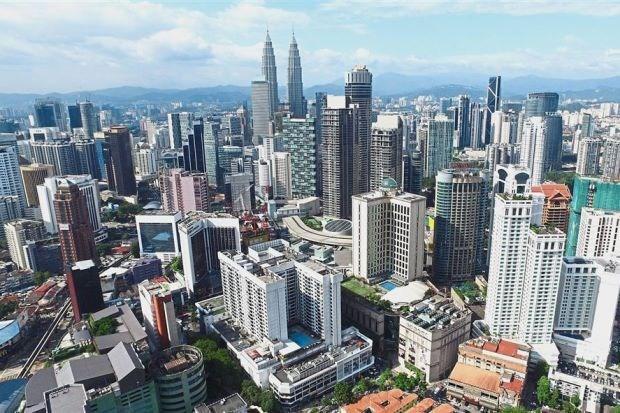 Fitch Solutions abaisse sa prevision de croissance en Malaisie hinh anh 1
