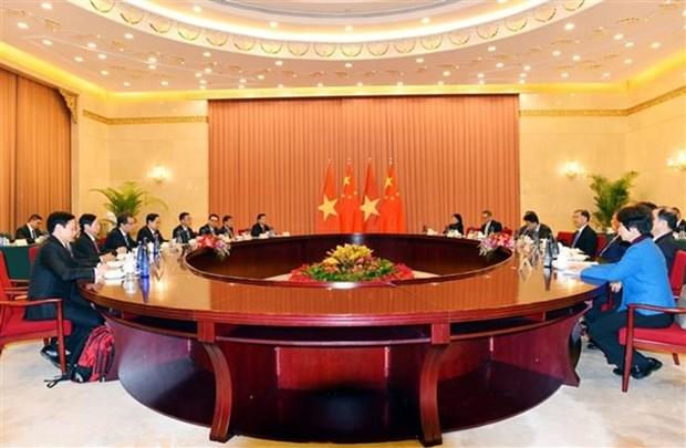 Activites du president du Comite central du Front de la Patrie du Vietnam en Chine hinh anh 1