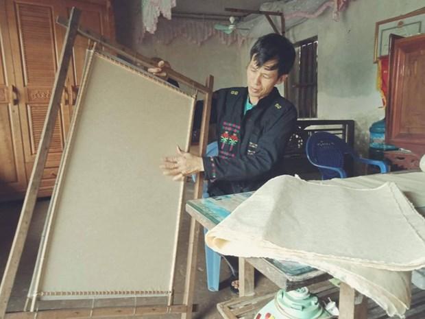De la pate au papier, dans les secrets de l'artisanat des Cao Lan hinh anh 1