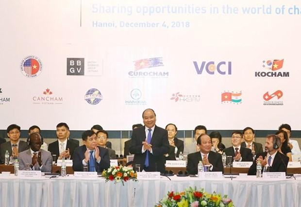 Le PM Nguyen Xuan Phuc s'adresse au Forum des entreprises du Vietnam hinh anh 1