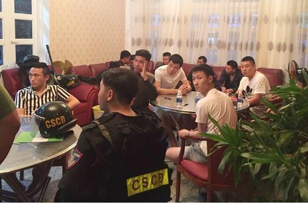 Vingt-deux Chinois arretes pour actes criminels de haute technologie hinh anh 1