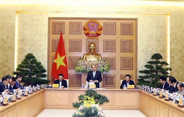 Le PM Nguyen Xuan Phuc travaille avec l'equipe de conseillers economiques hinh anh 1