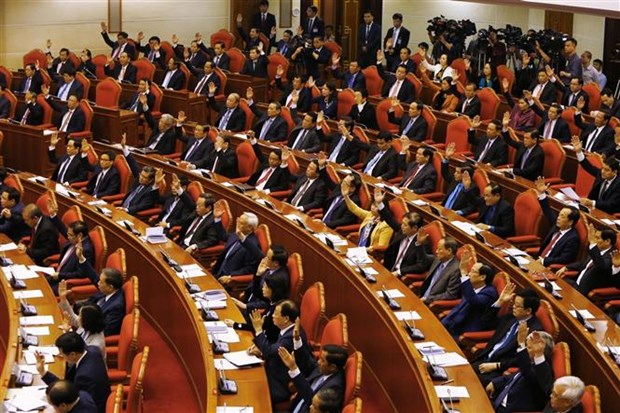 Deuxieme journee de travail du 9e Plenum du Comite central du Parti hinh anh 1