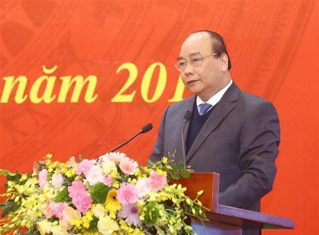Le PM assiste a une conference sur la sensibilisation aupres des masses hinh anh 1