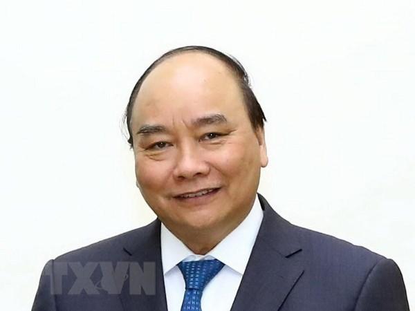 Le PM Nguyen Xuan Phuc participera au forum economique mondial de Davos hinh anh 1