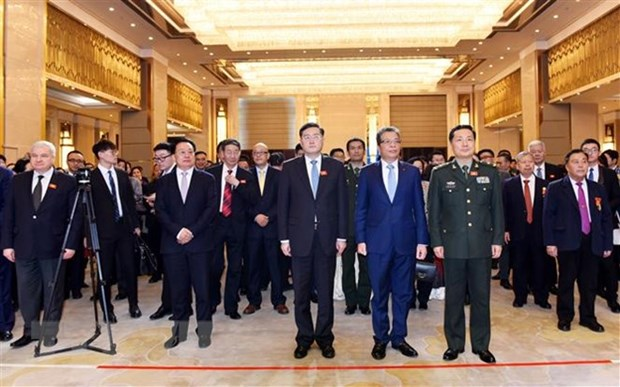 Celebration des 69 ans de l'etablissement des relations diplomatiques Vietnam-Chine hinh anh 1
