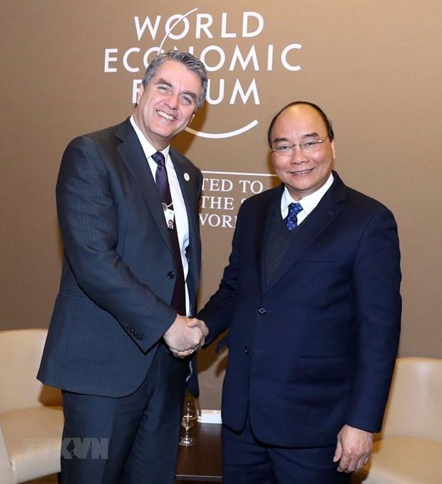 Activites du PM Nguyen Xuan Phuc dans le cadre du WEF 2019 hinh anh 3