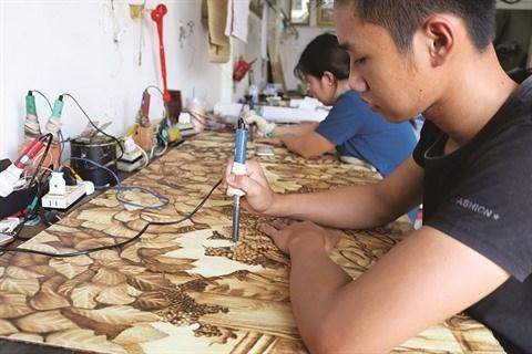 Gravure sur feuille de palmier hinh anh 2