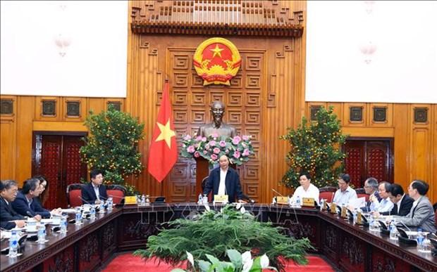 Le PM travaille avec des ministeres pour l'acceleration de l'achat de riz hinh anh 1
