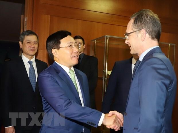La visite du vice-PM et ministre des AE en Allemagne est couronnee de succes hinh anh 1