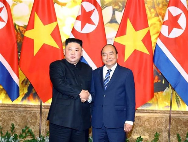 Le PM Nguyen Xuan Phuc rencontre le leader nord-coreen Kim Jong-un hinh anh 1