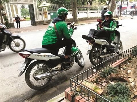 Taxi-moto connecte, pas une sinecure! hinh anh 1