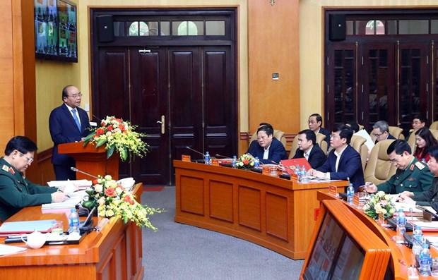 Le PM preside la conference pour construire des zones de defense ferme dans la nouvelle situation hinh anh 1