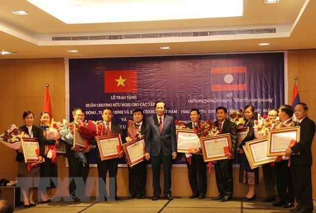 Vietnam et Laos promeuvent la cooperation dans le domaine du travail et du bien-etre sociale hinh anh 1