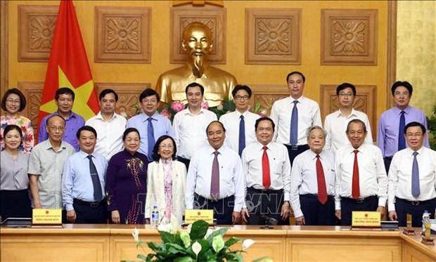 Le gouvernement et le Front de la Patrie evaluent les resultats de leur cooperation hinh anh 1