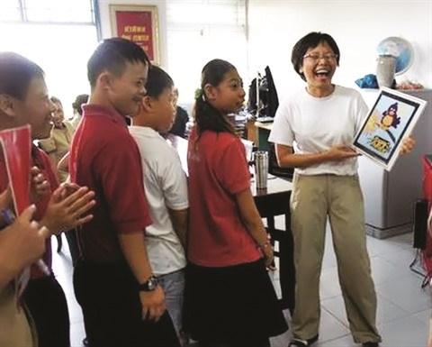 Peng-Sim Eng, devouee pour les enfants handicapes et autistes hinh anh 2