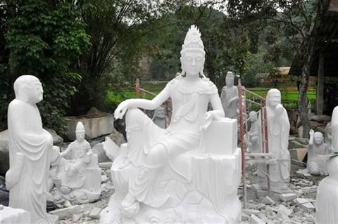 Precision et spiritualite: les sculptures de Luc Yen attirent l'œil ! hinh anh 1
