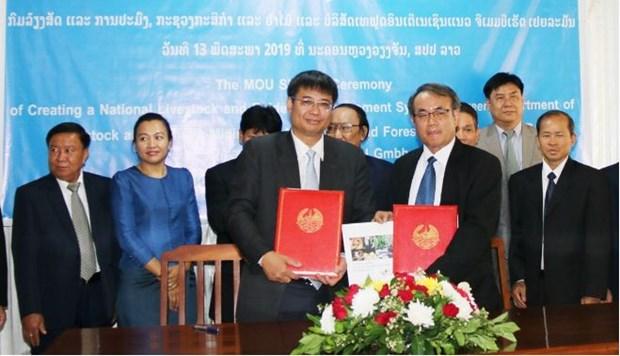 Une Sarl vietnamienne aide le Laos a s'informer pour prevenir les epizooties hinh anh 1