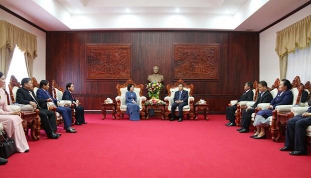 Le Vietnam et le Laos partagent leur experience sur la mobilisation des masses hinh anh 1