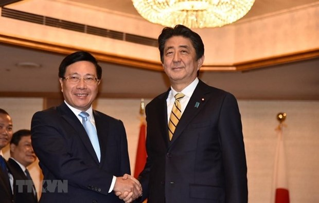 Le vice-PM Pham Binh Minh rencontre des dirigeants japonais et laotien a Tokyo hinh anh 1